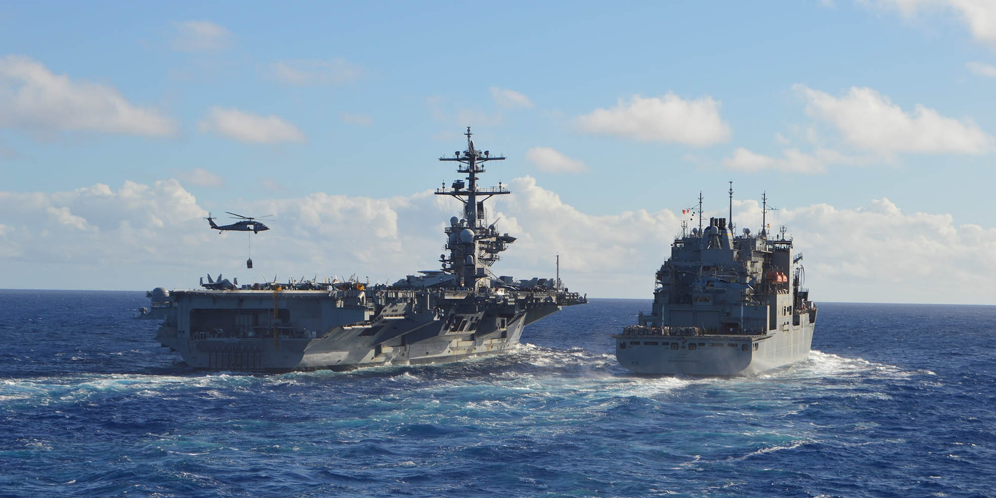 The Nimitz-class aircraft carrier USS Carl Vinson (CVN 70) conducts a replenishment-at-sea with Dry Cargo and Ammunition Ship USNS Washington Chambers (T-AKE 11) on Aug. 13, 2021