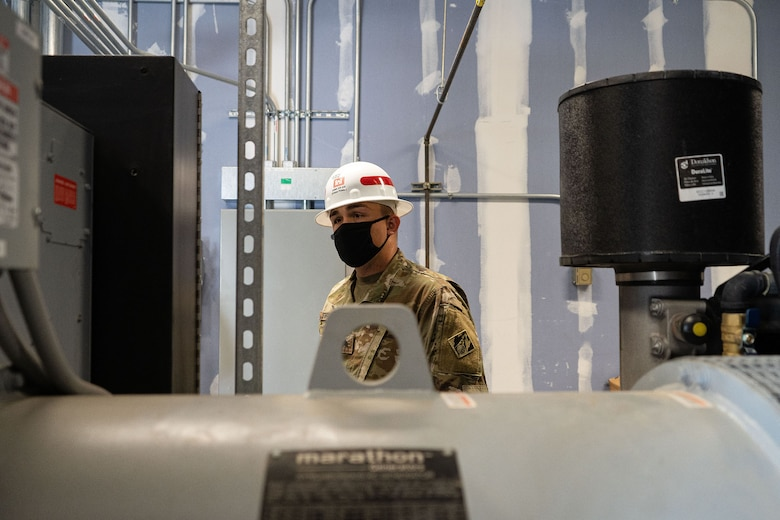 U.S. Army Sgt. Joseph Strupith, 249th Engineer Battalion Charlie Company Prime Power production specialist, assesses a facility's emergency power generation during Exercise Empire Rising 2021 at the U.S. Naval Academy in Annapolis, Md., July 13, 2021. As part of their National Response Framework mission, the 249th EN BN deploys to provide electrical expertise, conduct pre-installation inspections, and manage, configure, and install generators in support of Emergency Support Functions. (U.S. Army photo by Greg Nash)