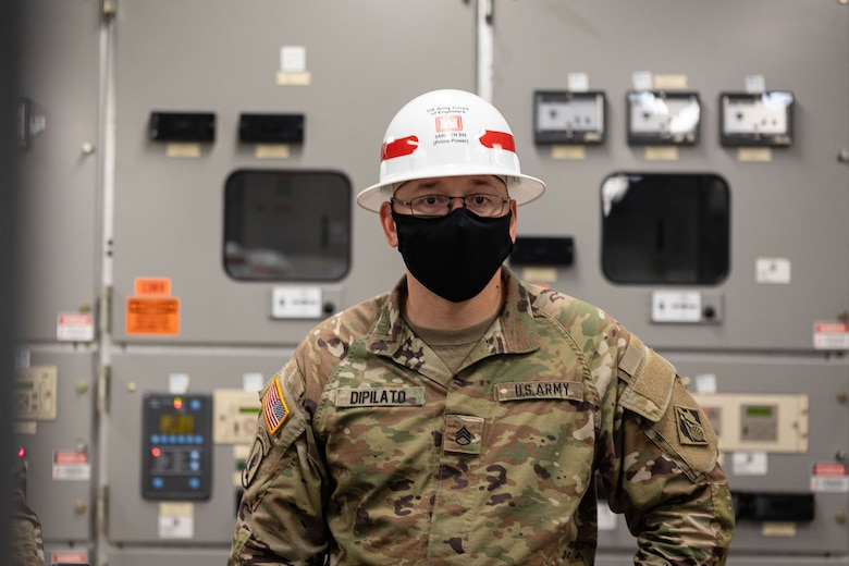 U.S. Army Staff Sgt. Daniel Dipilato, 249th Engineer Battalion Charlie Company Prime Power production specialist, assesses components in an electrical room as part of an evaluation during Exercise Empire Rising 2021 at the U.S. Naval Academy in Annapolis, Md., July 13, 2021. The 249th EB provides commercial-level power to military units and federal relief organizations during full-spectrum operations. It's charged with the rapid provision of Army generators to support worldwide requirements. (U.S. Army photo by Greg Nash)