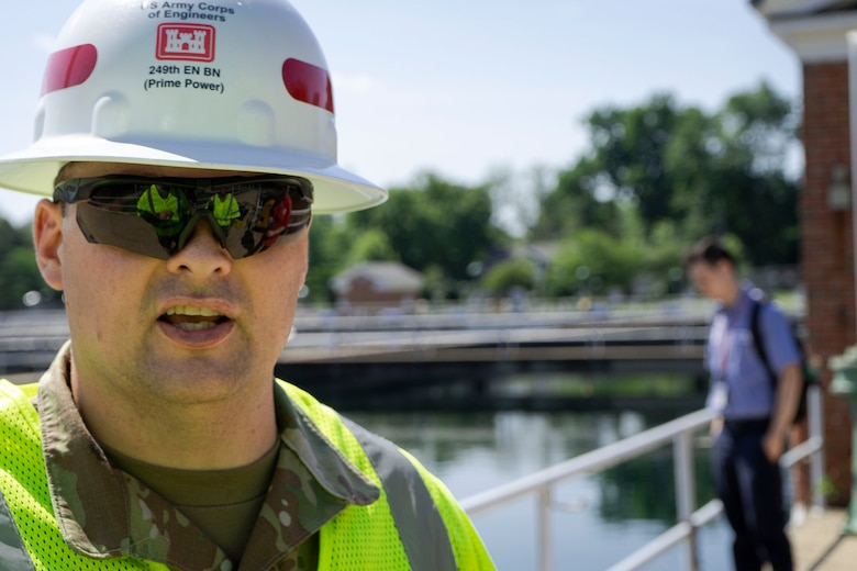 """U.S. Army Staff Sgt. Matthew Bradford, 249th Engineer Battalion Charlie Company Prime Power production specialist, stands at the Washington Aqueduct during Exercise Empire Rising 2021 in Washington, D.C., July 14, 2021. During the validation exercise, the 249th Prime Power """"Spartans"""" assessed power generators that helps the Washington Aqueduct's drinking water production that services approximately one million citizens living, working, or visiting in the District of Columbia, Arlington County, Virginia, and other areas in northern Virginia to include portions of Fairfax County. (U.S. Army photo by Greg Nash)"""