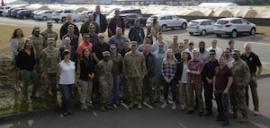 Col. Terrence M. Joyce, Office of Special Investigations Field Investigations Region 5 Commander, center in front row, is joined by members of one of the two 5 FIR Screening Teams assembled at Ramstein Air Base, Germany, to support Operation Allies Refuge. (Photo submitted by 5 FIR)
