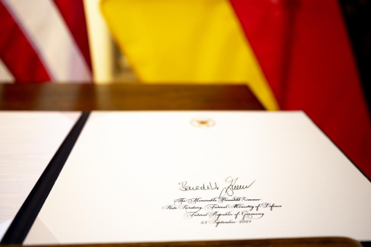 A folder with a signature sits on a table.