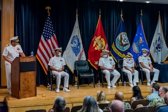 Capt. Dean Muriano, reads his orders to report as commanding officer, Center for Explosive Ordnance Disposal and Diving (CEODD), during a change of command ceremony where Muriano relieved Capt. Keith Dowling, Sept. 22.