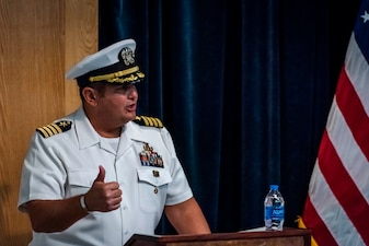Capt. Dean Muriano, commanding officer, Center for Explosive Ordnance Disposal and Diving (CEODD), delivers remarks after relieving Capt. Keith Dowling during a change of command ceremony, Sept. 22.