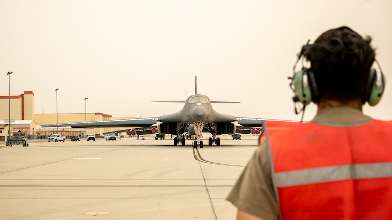 Ground crews prepare a B-1B Lancer, tail number 85-0074, for its final flight out of Edwards Air Force Base, California, Sept. 23.