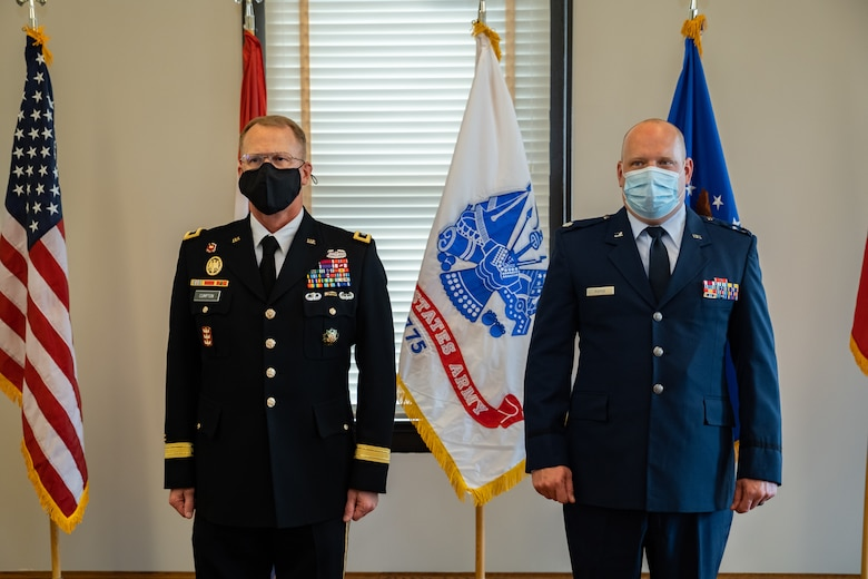 Adjutant General of the Missouri National Guard Maj. Gen. Levon Cumpton and Lt. Col. Matthew Pieper, a Center for Sustainment of Trauma and Readiness Skills instructor, stand at attention during a ceremony at Jefferson Barracks Air National Guard Base, Missouri, September 12, 2021. Pieper was presented with the Distinguished Flying Cross for his lifesaving actions during a 2018 aeromedical evacuation flight while deployed to Afghanistan. (U.S. Air National Guard photo by Master Sgt. Stephen Froeber)
