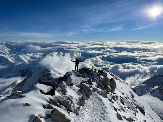 man stand on top of a mountain