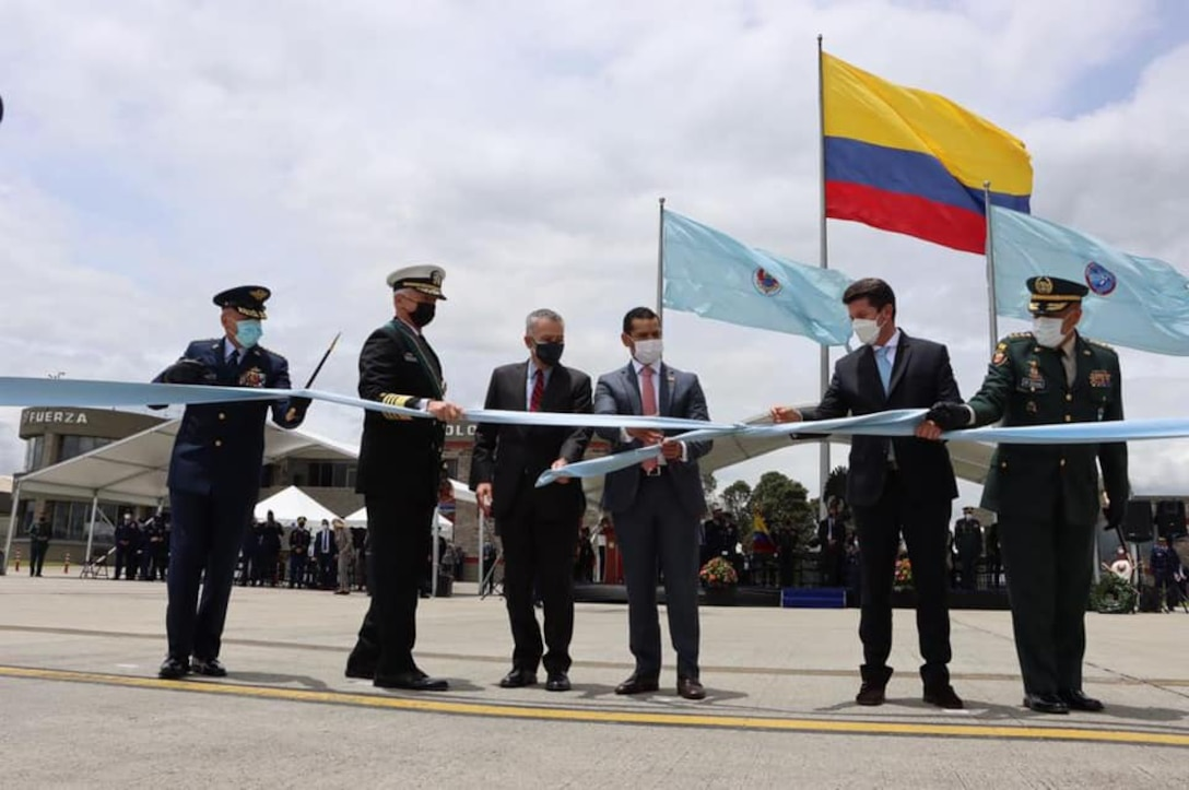 U.S. Navy Adm. Craig S. Faller, commander of U.S. Southern Command, takes part in a ceremony as the U.S. donates two C-130H Hercules aircraft to Colombia's Military Air Transport Command.