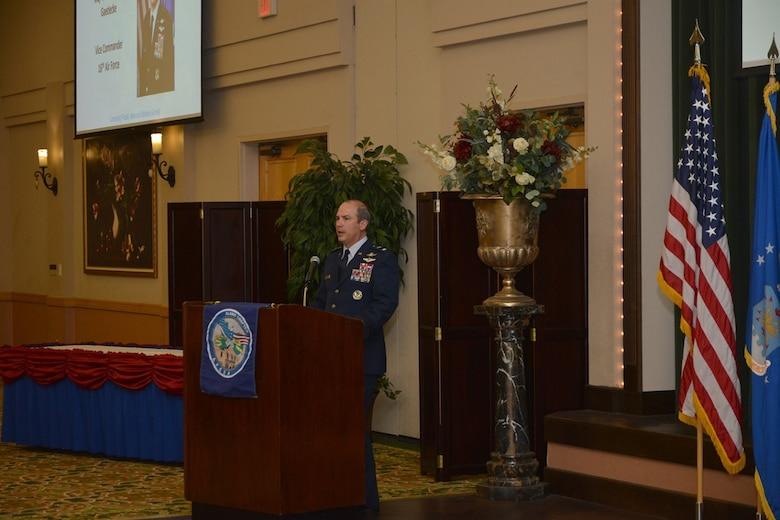 Maj. Gen. in official blues uniform speaks in front of a podium.