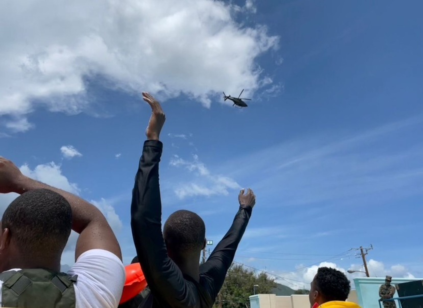 Service member waves to helicopter