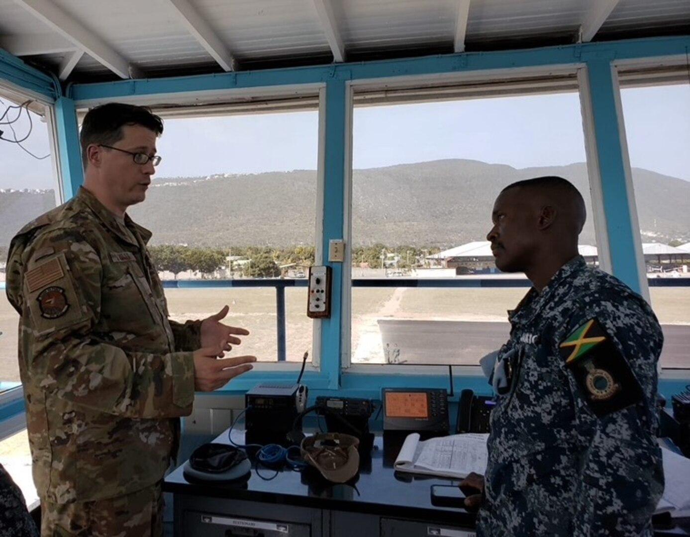U.S. and Jamaican service members talk in Kingston.
