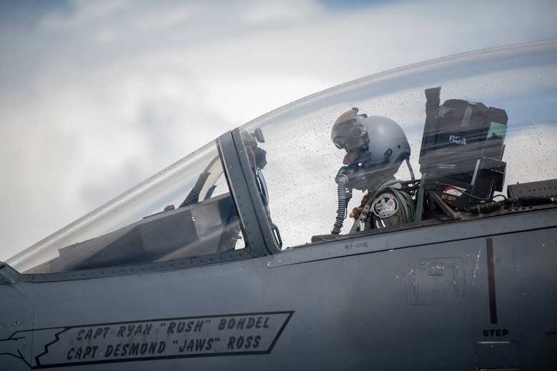Pilot sitting in the cockpit of a plane