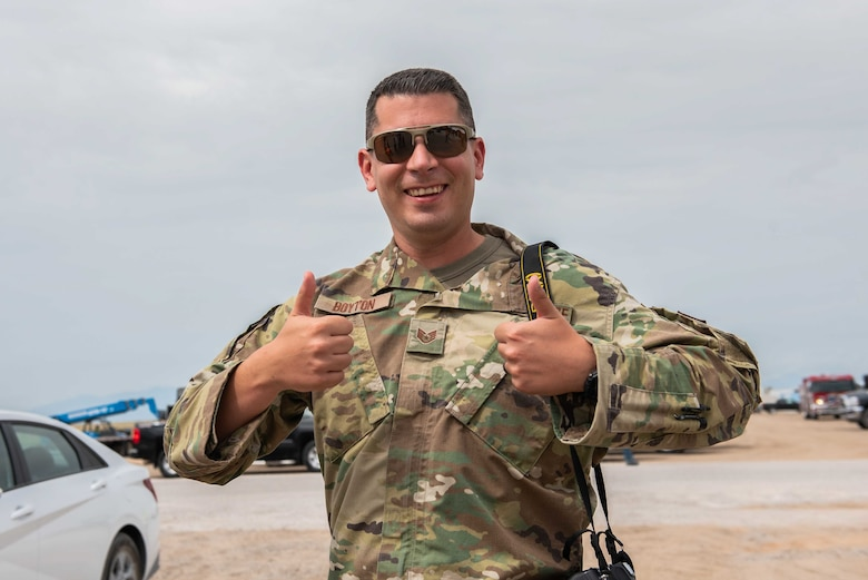 U.S. Air Force Staff Sgt. Kenneth Boyton, Task Force-Holloman Public Affairs specialist deployed from Seymour Johnson Air Force Base, North Carolina, poses for a photo Sept. 1, 2021 at Aman Omid Village in support of Operation Allies Welcome at Holloman Air Force Base, New Mexico. Boyton is tasked with documenting the ongoing TF-H mission at Holloman. The Department of Defense, through U.S. Northern Command, and in support of the Department of State and Department of Homeland Security, is providing transportation, temporary housing, medical screening, and general support for at least 50,000 Afghan evacuees at suitable facilities, in permanent or temporary structures, as quickly as possible. This initiative provides Afghan evacuees essential support at secure locations outside Afghanistan. (U.S. Army photo by Spc. Nicholas Goodman)