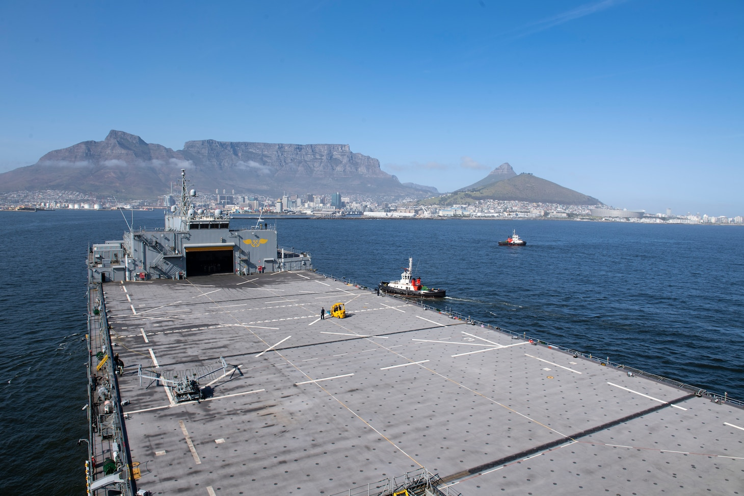 """The Expeditionary Sea Base USS Hershel """"Woody"""" Williams (ESB 4) pulls into port in Cape Town, South Africa, Sept. 25, 2021. Hershel """"Woody"""" Williams is on a scheduled deployment in the U.S. Sixth Fleet area of operations in in support of U.S. national interests and security and stability in Europe and Africa."""