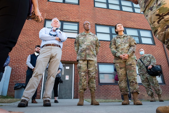 Secretary of the Air Force Frank Kendall, Chief of Staff of the Air Force Gen. CQ Brown, Jr. and Chief Master Sergeant of the Air Force JoAnne Bass, receive a briefing detailing life inside Liberty Village during a visit to Joint Base McGuire-Dix-Lakehurst, New Jersey, Sept. 25, 2021. The Department of Defense, through U.S. Northern Command, and in support of the Department of Homeland Security, is providing transportation, temporary housing, medical screening, and general support for at least 50,000 Afghan evacuees at suitable facilities, in permanent or temporary structures, as quickly as possible. This initiative provides Afghan personnel essential support at secure locations outside Afghanistan. (U.S. Air Force photo by Staff Sgt. Jake Carter)