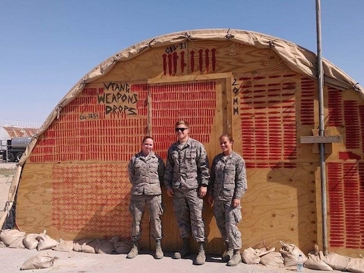 United States Air Force Airman 1st Class Caitlyn Durant (left), an aircraft armaments specialist, poses for a photo with other members of the 158th Fighter Wing, Vermont Air National Guard, during a deployment in February of 2016 to an undisclosed location in Southeast Asia. Now, Durant is a staff sergeant and has been with the 104th Fighter Wing, Massachusetts Air National Guard's Weapons Flight since January of 2021. (U.S. Air National Guard courtesy photo)