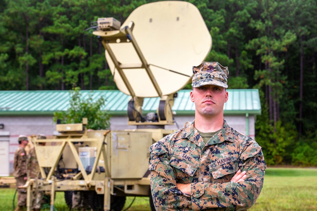 """U.S. Marine Corps Lance Cpl. Dylan Sams, a Wideband Satellite Systems Maintainer assigned to 26th Marine Expeditionary Unit, is titled Motivator of the Week for his dedicated work ethic and technical proficiency during Operation Allies Welcome on Fort Pickett, Virginia, Sept. 22, 2021. """"I really believe I am just doing my job,"""" Sams said. """"I help people and when I see that something needs to get done, I get it done."""" According to his leadership, Sams conducted over 60 hours of troubleshooting on four satellite transmissions systems while also identifying multiple faults on satellite communication systems. Sams also assisted the U.S. Army 62nd Expeditionary Signal Brigade in getting their system online in support of 1st Battalion, 506th Infantry Regiment. (U.S. Marine Corps photo by Cpl. Eric Ramirez)"""