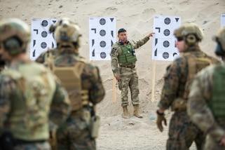 U.S. and Peruvian Marines conduct live fire training.