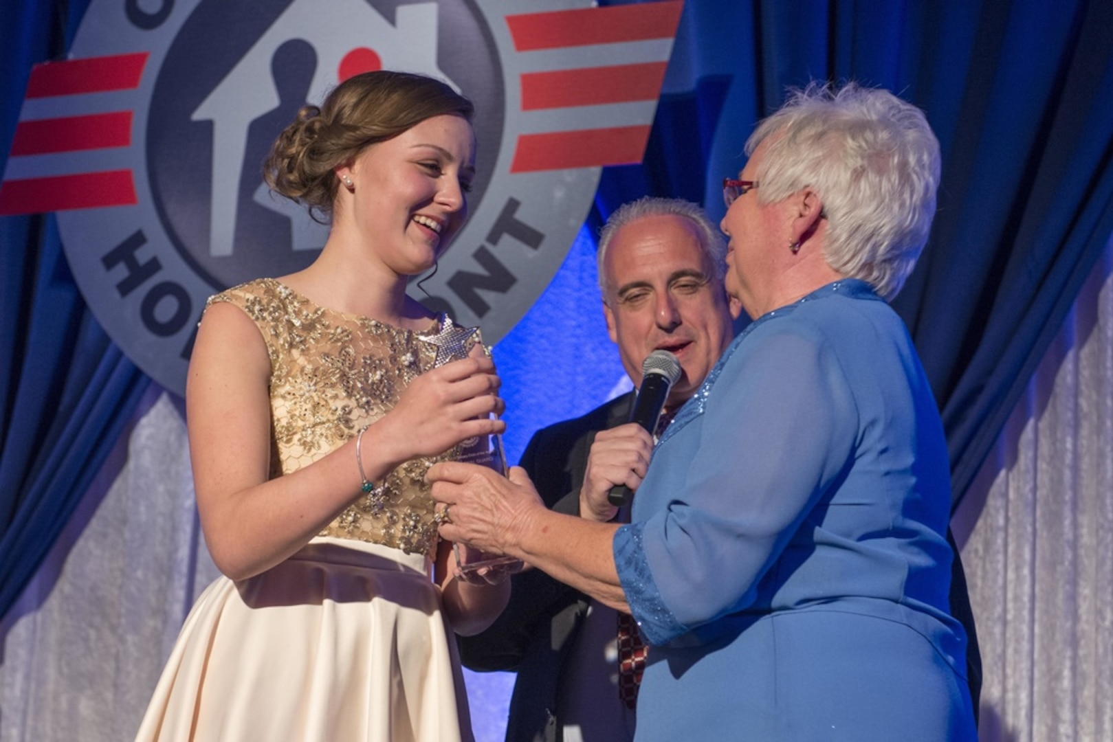 WASHINGTON- Molly Frey, left, receives the Military Child of the Year® award for the National Guard from her grandmother during the 2017 Military Child of the Year® Awards gala at a Ritz-Carlton hotel. Each year, the Military Child of the Year® Award is presented by Operation Homefront to outstanding military children who demonstrate resiliency, leadership and achievement. (U.S. Navy photo my Mass Communication Specialist 3rd Class Eric S. Brann /Released)
