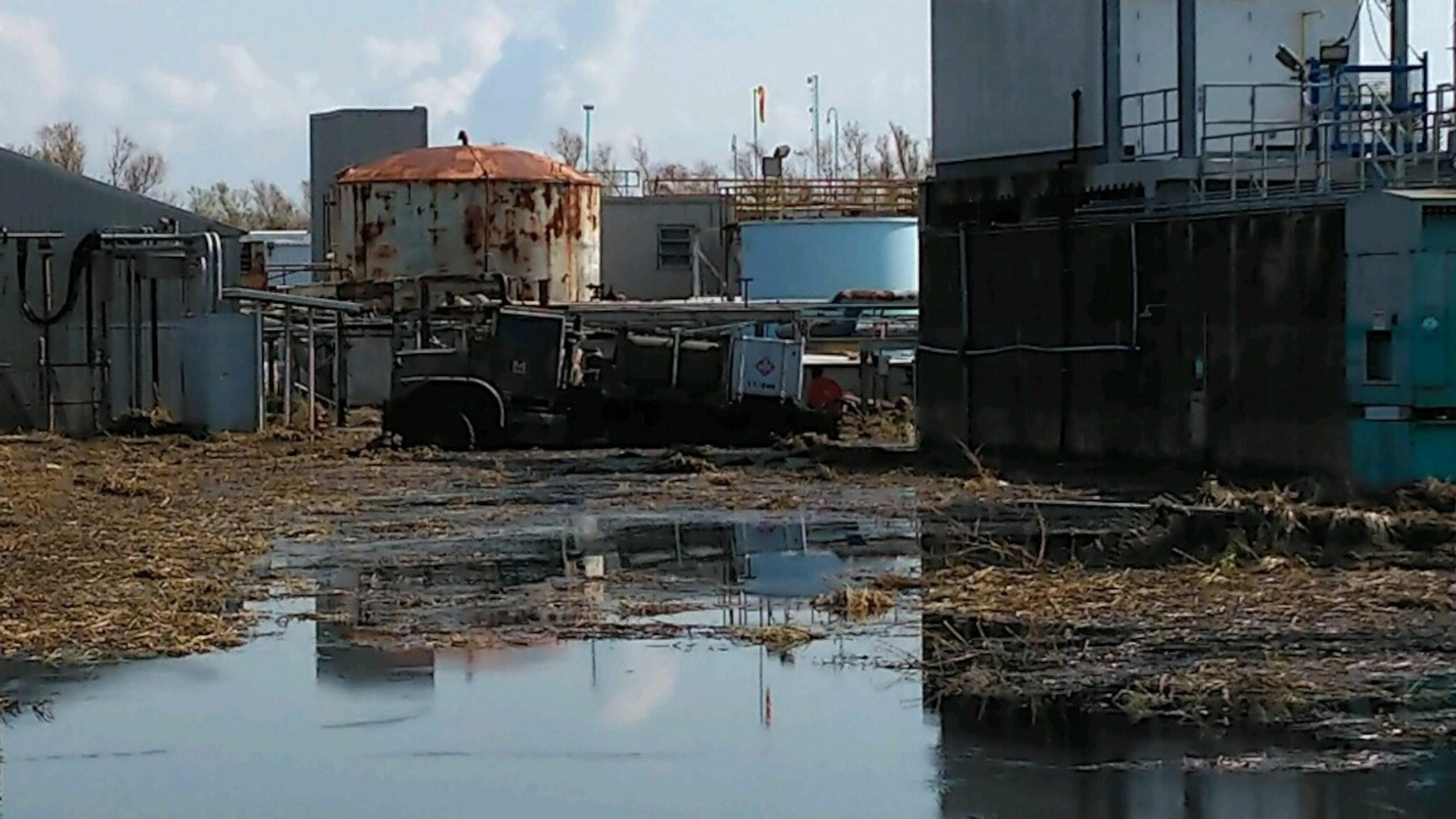 a high water truck stuck in hurricane debris