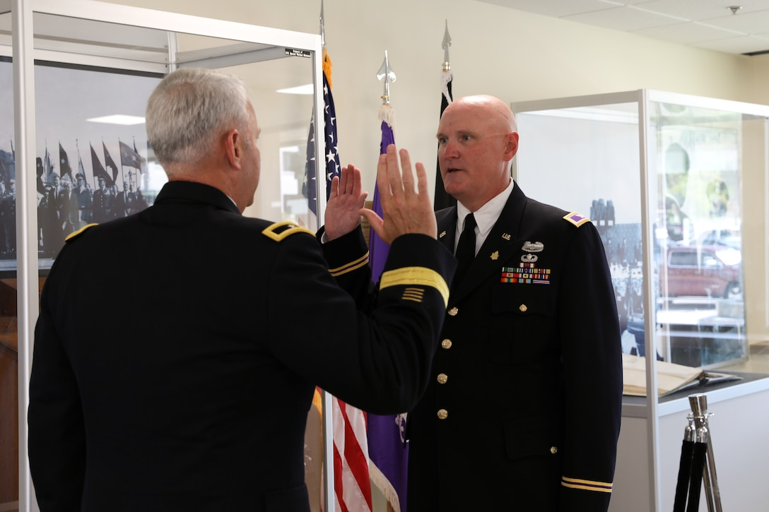 U.S. Army Reserve Col. Donald A. (Tony) Vacha, incoming deputy commanding officer for the 353 Civil Affairs Command, recites the oath of office given by Brig. Gen. Robert S. Cooley, chief of staff, U.S. Army Reserve Command, during his promotion ceremony at the John F. Kennedy Special Warfare Center and School, Aug. 27, 2021, Fort Bragg, N.C.