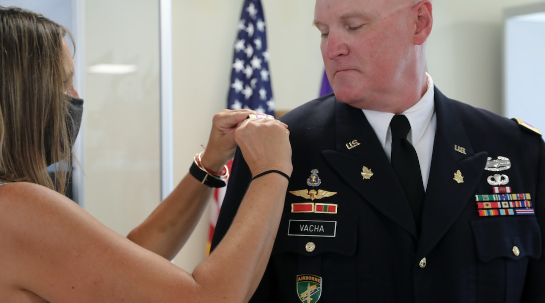 Mrs. Lara Vacha pins the rank of colonel on her husband, U.S. Army Reserve Col. Donald A. (Tony) Vacha, incoming deputy commanding officer for the 353 Civil Affairs Command, during his promotion ceremony held at the John F. Kennedy Special Warfare Center and School, Aug. 27, 2021, Fort Bragg, N.C.