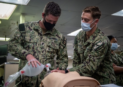 210914-N-DA693-3002 SAN DIEGO (Sept. 13, 2021) Hospital Corpsman 3rd Class Eric Callari, a Sailor embarked with the Medical Treatment Facility's (MTF) Directorate for Nursing Services aboard Military Sealift Command (MSC) hospital ship USNS Mercy (T-AH 19) (left), and Lt. Matthew Kirchoff (right), participate in a resuscitation drill in one of the ship's intensive care units during Mercy Exercise (MERCEX) 21-4 Sept. 13. MERCEX 21-4 is a week-long, pierside