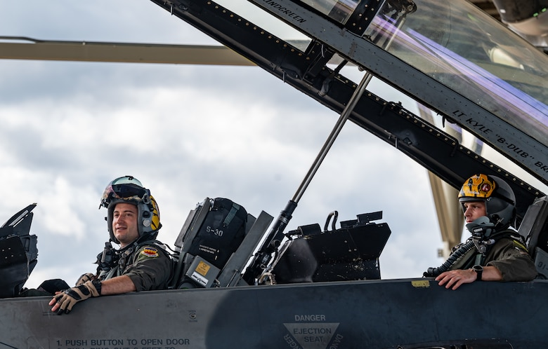 Photo of Airmen preparing to takeoff in an F-16