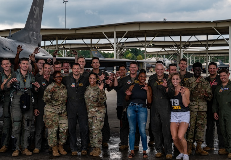 Photo of a group of Airmen and their families