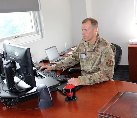 Col. Robert Lance, chief of the Arnold Engineering Development Complex Test Support Division, works in his office at Arnold Air Force Base, Tenn., Aug. 20, 2021. (U.S. Air Force photo by Deidre Moon) (This image has been altered by blurring a badge for security purposes.)