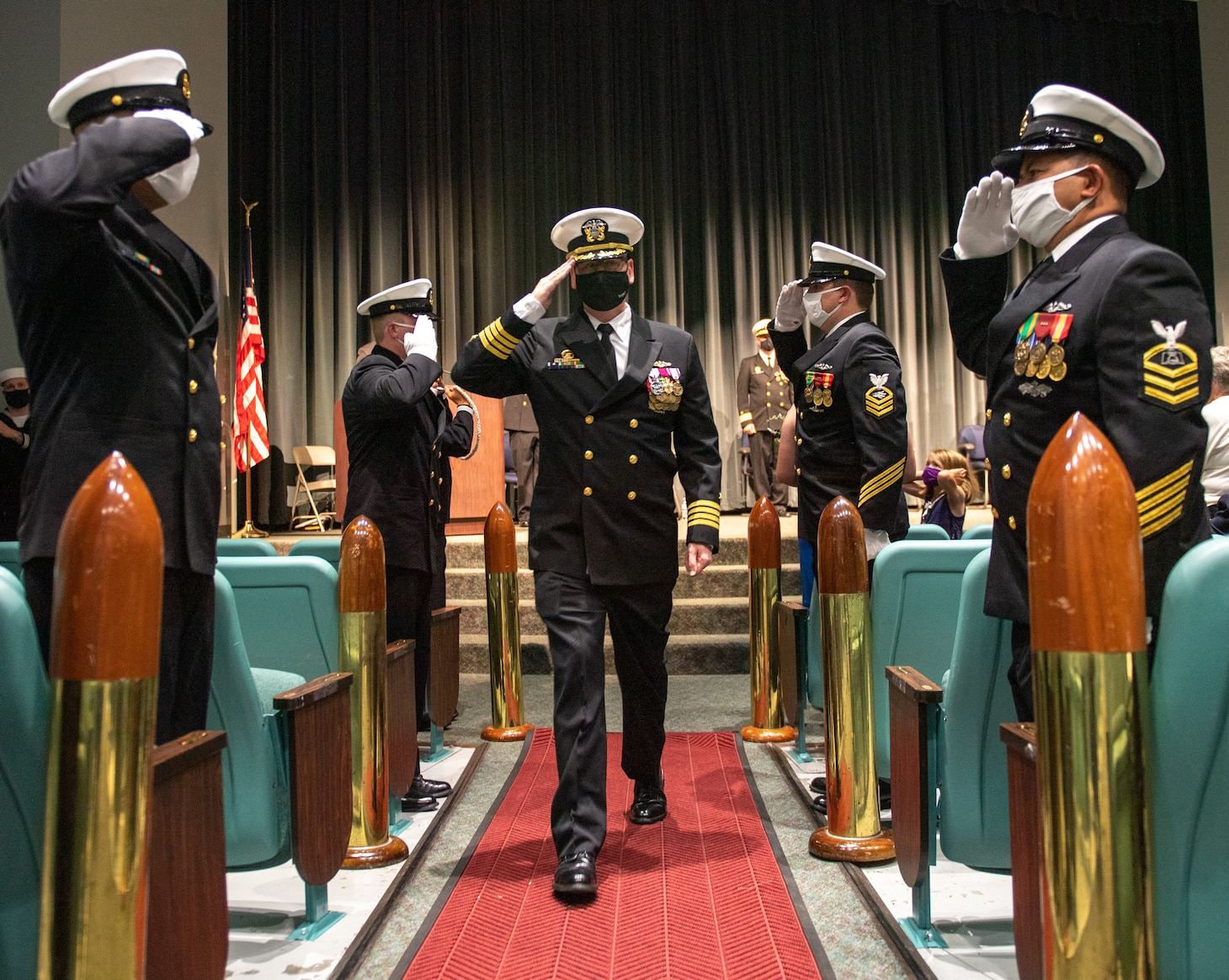Capt. John Cage, commander, Submarine Squadron 20, is saluted by sideboys during a change of command ceremony held at Naval Undersea Museum in Keyport, Washington Sept. 9, 2021. During the ceremony, Cmdr. Travis Wood relieved Cmdr. Robert Garis as commanding officer of USS Maine (SSBN 741) Gold Crew. (U.S. Navy Photo by Mass Communication Specialist 2nd Class Emilia C. Hilliard)
