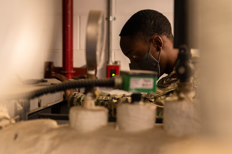 Senior Airman Sherquon Anderson, 51st Civil Engineering Squadron heating ventilation and air conditioning (HVAC) technician, works on an air handling unit