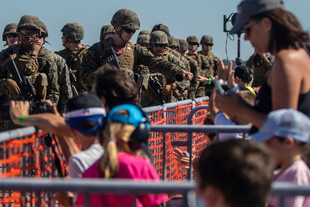 U.S. Marines with 2nd Low Altitude Air Defense Battalion greet community members at the 2021 Air Show at Marine Corps Air Station Cherry Point, North Carolina, Sept. 25, 2021.The air show is MCAS Cherry Point and the 2D Marine Aircraft Wing's immense, community outreach event that is a show of appreciation to its regional neighbors and community partners for their enduring support in mission success. (U.S. Marine Corps photo by Cpl. Yuritzy Gomez)