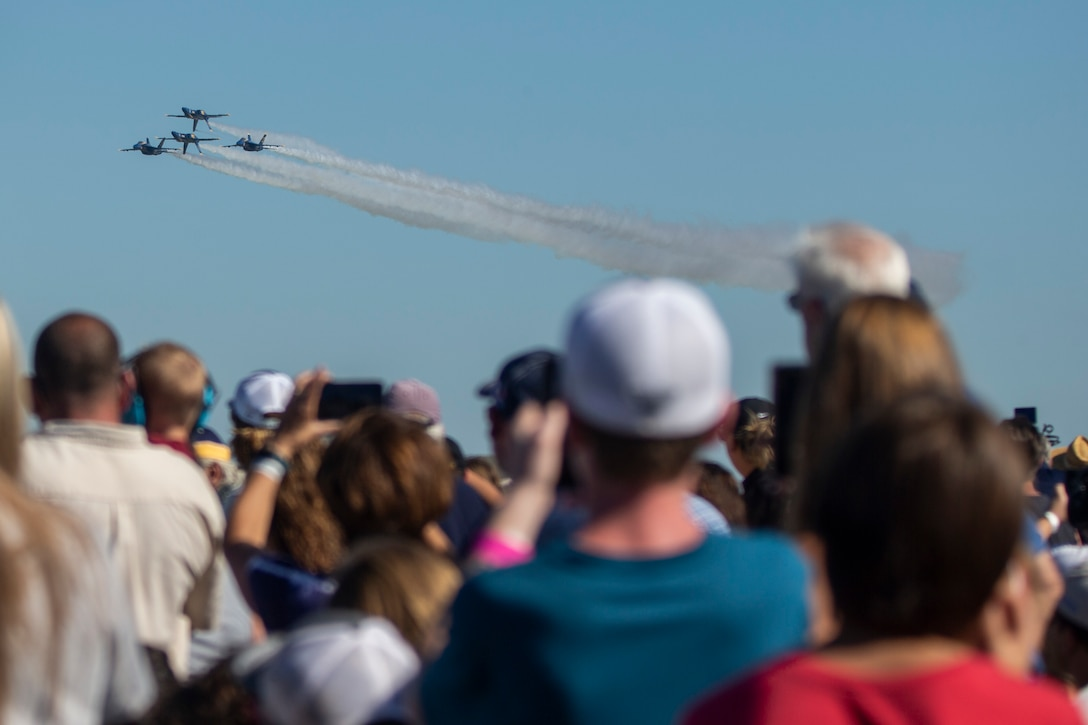 The U.S. Navy Blue Angels preform for the community during the 2021 Air Show at Marine Corps Air Station Cherry Point, North Carolina, Sept. 25, 2021.The air show is MCAS Cherry Point and the 2D Marine Aircraft Wing's immense, community outreach event that is a show of appreciation to its regional neighbors and community partners for their enduring support in mission success. (U.S. Marine Corps photo by Cpl. Yuritzy Gomez)