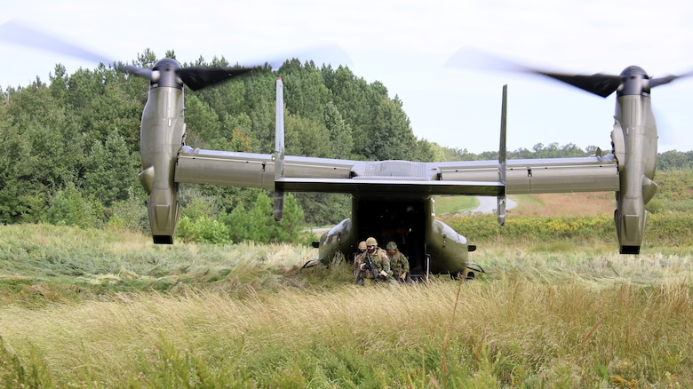 Participants exit an MV-22B Osprey to enter the simulated training village during Information Warfighter Exercise on Marine Corps Base Quantico, Va., Sep. 20, 2021. During week two, participants go through training lanes and interact with role players in order to test their skill levels in different tactical situations. IWX is a semi-annual multinational exercise designed to educate and train military service members with real-world scenarios to accomplish operations in the information environment.