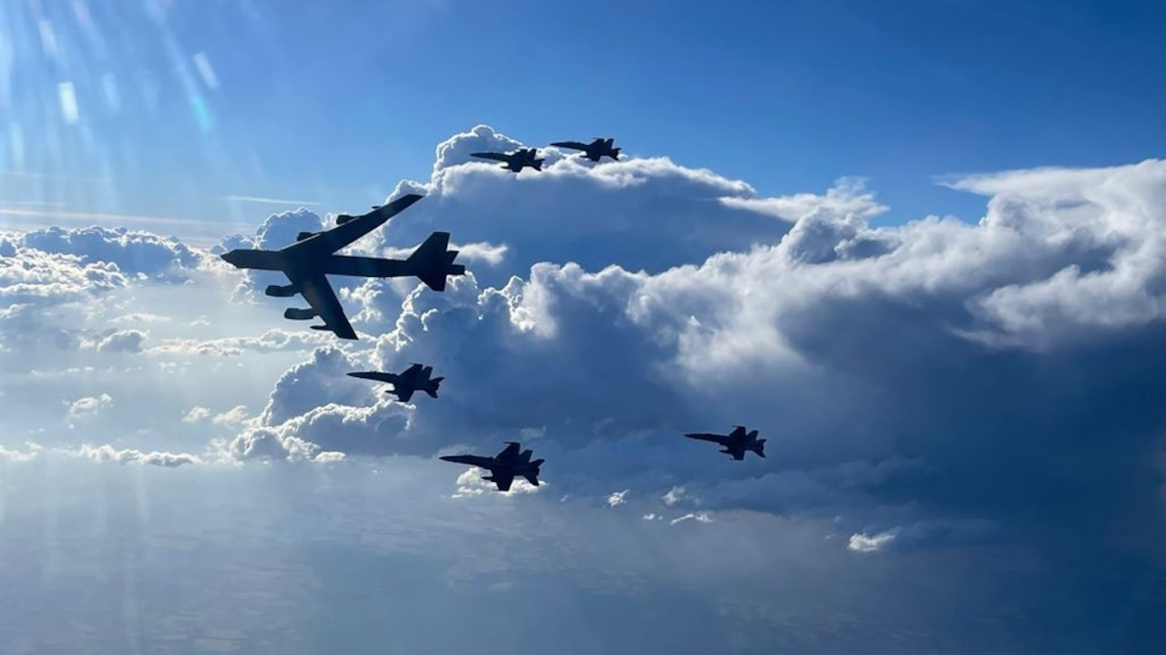 A U.S. Air Force B-52H Stratofortress flies in formation with Spanish air force F-18 aircraft.
