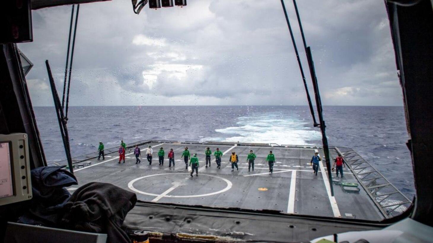 USS Charleston Sailors Conduct FOD Walk Down