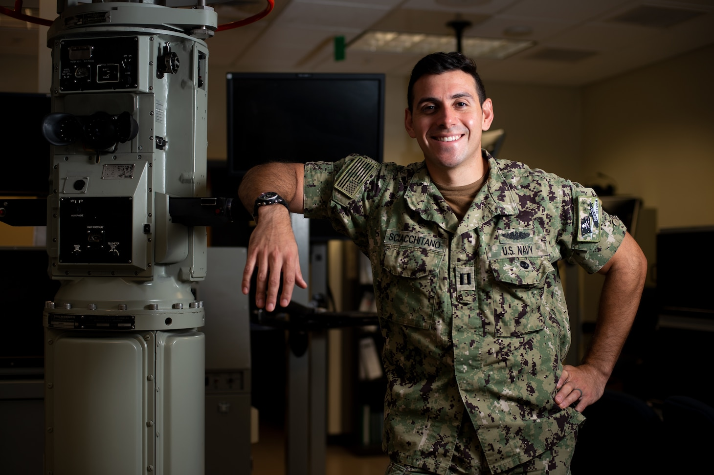 SANTA RITA, Guam (Feb. 17, 2021) Lt. Alfonso Sciacchitano, a native of Marietta, Georgia, assigned to Naval Submarine Training Center Pacific, Detachment Guam, poses for a portrait in the Submarine Multi-Mission Team Trainer at Konetzni Hall. Sciacchitano was announced as the 2020 Naval Education and Training Command Officer Instructor of the Year. (U.S. Navy photo by Mass Communication Specialist 2nd Class Kelsey J. Hockenberger)