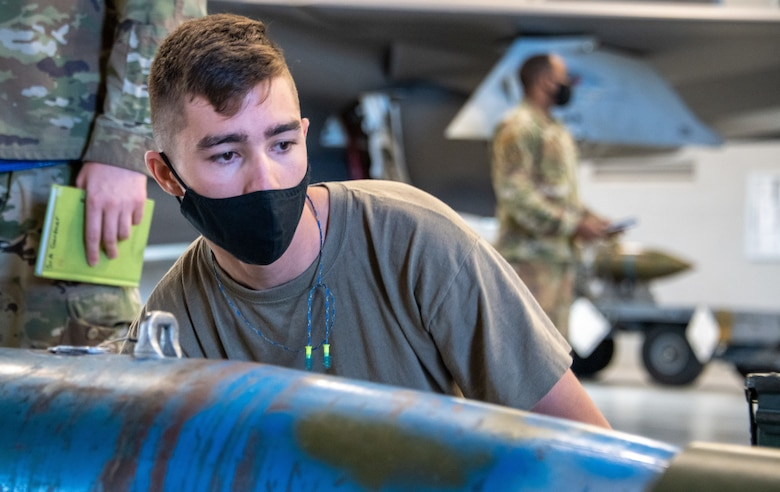 U.S. Air Force Staff Sgt. Connor Hansen from the 419th Aircraft Maintenance Squadron inspects an unarmed GBU-12 Pave Way bomb during a weapons load competition at Hill Air Force Base, Utah on Sept. 24, 2021. The quarterly competition focuses on speed, accuracy and safety, and ensures standard loading procedures and proficiency across the wings. (U.S. Air Force photo by Senior Airman Erica Webster)