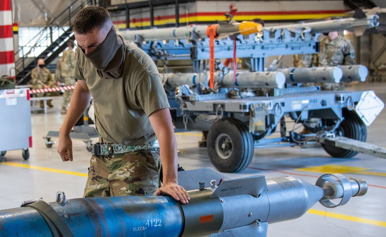 U.S. Air Force Master Sgt. Jonathan Thorsted from the 419th Aircraft Maintenance Squadron ensures an unarmed GBU-12 Pave Way bomb is properly secured before loading it onto an F-35A Lightning II during a weapons load competition at Hill Air Force Base, Utah on Sept. 24, 2021. The quarterly competition focuses on speed, accuracy, and safety, ensuring standard loading procedures and proficiency across the wings. (U.S. Air Force photo by Senior Airman Erica Webster)