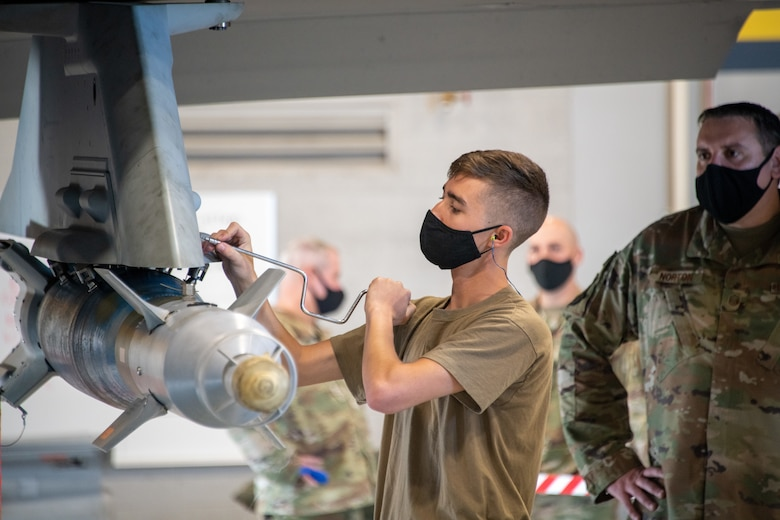 U.S. Air Force Staff Sgt. Connor Hansen from the 419th Aircraft Maintenance Squadron secures an unarmed bomb to an F-35A Lightning II aircraft during a weapons load competition at Hill Air Force Base, Utah on Sept. 24, 2021. The quarterly competition focuses on speed, accuracy, and safety, ensuring standard loading procedures and proficiency across the wings. (U.S. Air Force photo by Senior Airman Erica Webster)