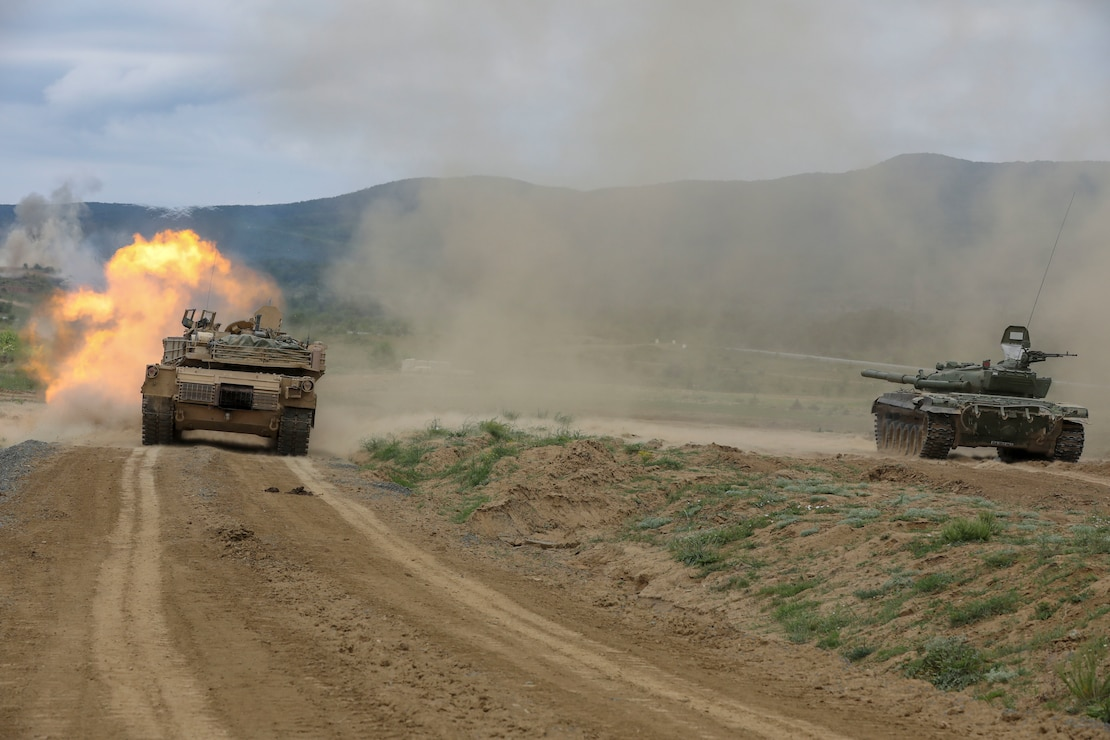 A U.S. Army M1A2 Abrams tank fires upon its target alongside a Bulgarian Armed Forces T-72 main battle tank during a live-fire exercise in support of Saber Guardian at Novo Selo Training Range in Bulgaria, May 30, 2021. The U.S. Army Corps of Engineers, Europe District is managing several range improvement projects at the Novo Selo Training Area, which is a key training area during international exercises in Europe like Saber Guardian. (U.S. Army photo by Spc. Christian Cote)