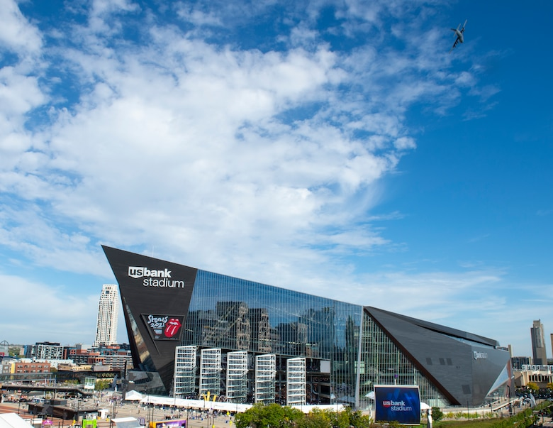 A C-130 Hercules from the 133rd Airlift Wing conducts a flyover at the Minnesota Vikings home opener game in Minneapolis, Minnesota, Sept. 26, 2021.