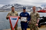 """The Coast Guard Cutter Maple hosts an international """"Heat and Beat"""" competition on the buoy deck in Greenland, June 25, 2021. Joint Arctic Command representatives, along with Cmdr. Eric Casler, won the competition with the fastest time and flattest pin. (U.S. Coast Guard photo by Petty Officer 3rd Class Jose Hernandez)"""