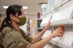 Pharmacy technician fills a prescription bottle