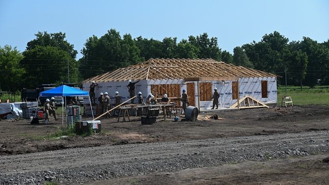 Members from the 175th Wing, Maryland Air National Guard, and the 123rd Airlift Wing, Kentucky Air National Guard, build a home for Cherokee veterans in Tahlequah, Oklahoma, Aug. 3, 2021, as part of the Defense Department's Innovative Readiness Training program.