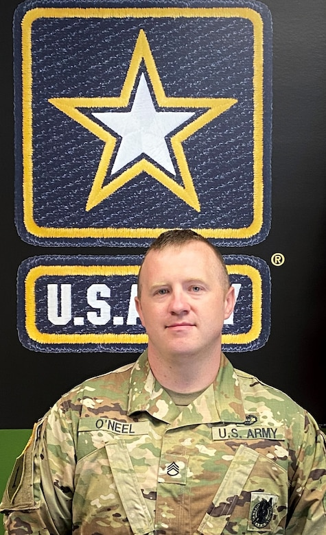 man wearing army uniform with a graphic background.
