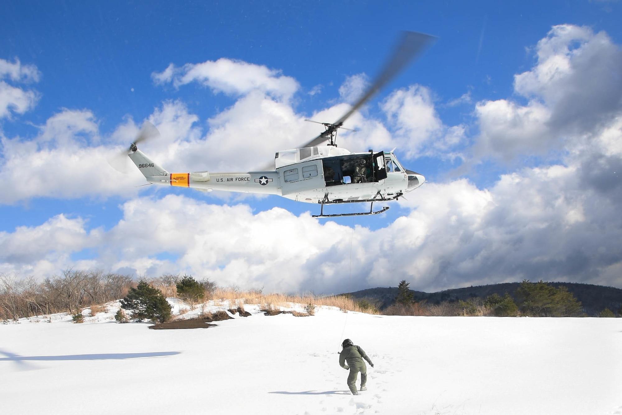 Lt. Col. Valerie Johnson walks towards a UH-1N Iroquois