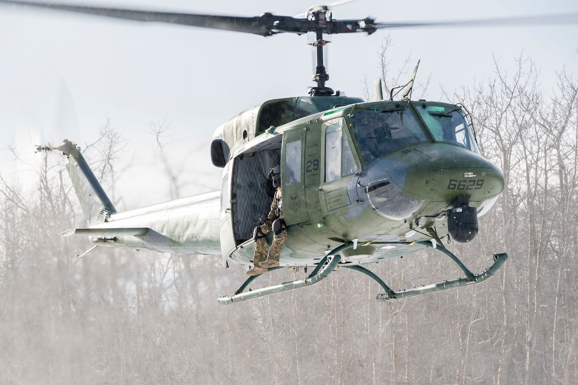 A 54th Helicopter Squadron UH-1N Iroquois hovers over the Turtle Mountain State Forest, N.D.