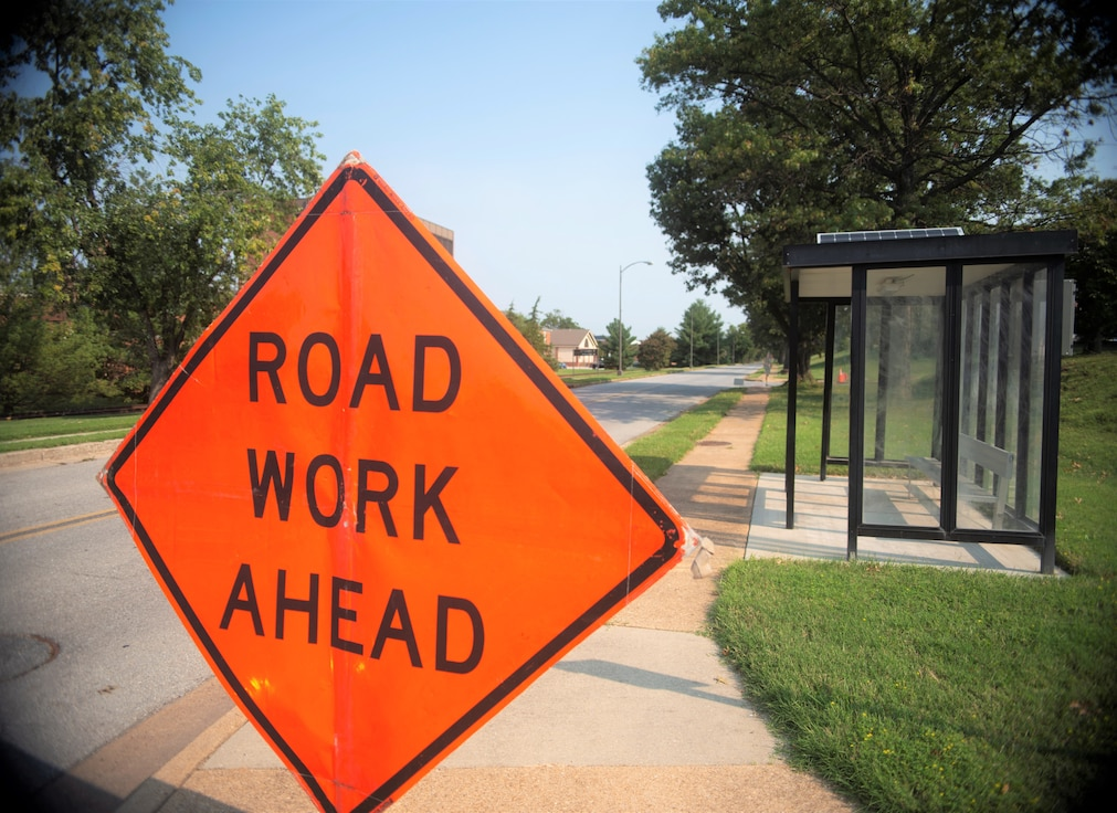 """A """"road work ahead"""" sign on the sidewalk ahead of Theisen Street near the Bolling Club at Joint Base Anacostia-Bolling, Sept 13, 2021."""